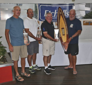 RQYS Commodore presents Iain Murray, Richie Allanson and Colin Beashel with their loot for winning the 2019 Etchells Australian Championship.